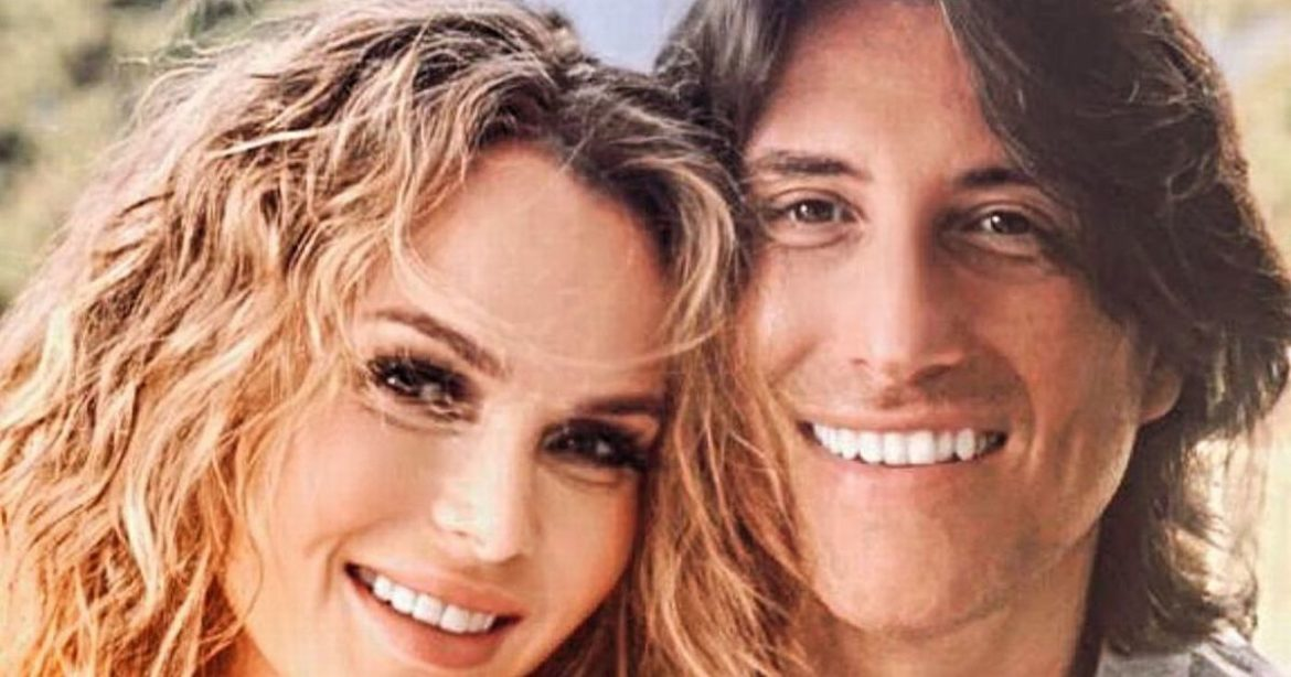 Amanda Holden provides uncommon have a look at pure curly hair in snap with husband