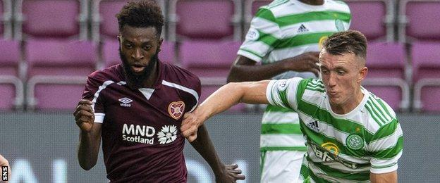 Hearts' Beni Baningime takes on Celtic's David Turnbull