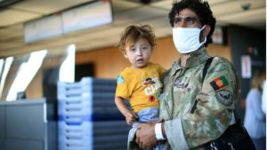 A thin length of yellow tape cordoned off the new arrivals - hundreds of Afghan refugees fresh off the plane from Kabul airport - from the intrusion of their new world, the grounds of an exhibition centre in Chantilly, Virginia.