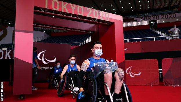 Members of the NZ wheelchair rugby team arrive on court