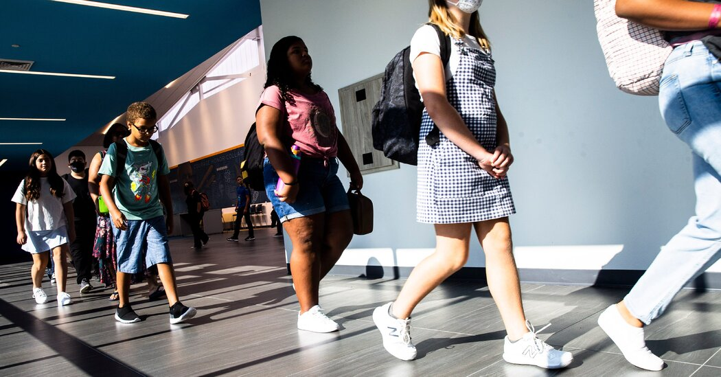 College Masks Debate Assessments Arizona's Governor